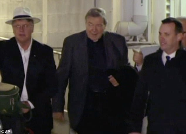 Cardinal Pell (pictured, centre) as he arrived in Sydney earlier this week on a flight from Singapore