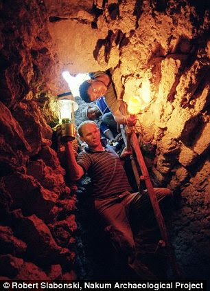 Into the cavern: Archaeologists descend into Nakum's pyramid which was formally known as Structure 15