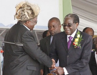 President Mugabe greets the son of the late Vice President Dr Joshua Mqabuko Nkomo,Sibangilizwe, at the official opening of the Joshua Mqabuko Nkomo International Airport in Bulawayo on Sunday December 22, 2013. by Pan-African News Wire File Photos