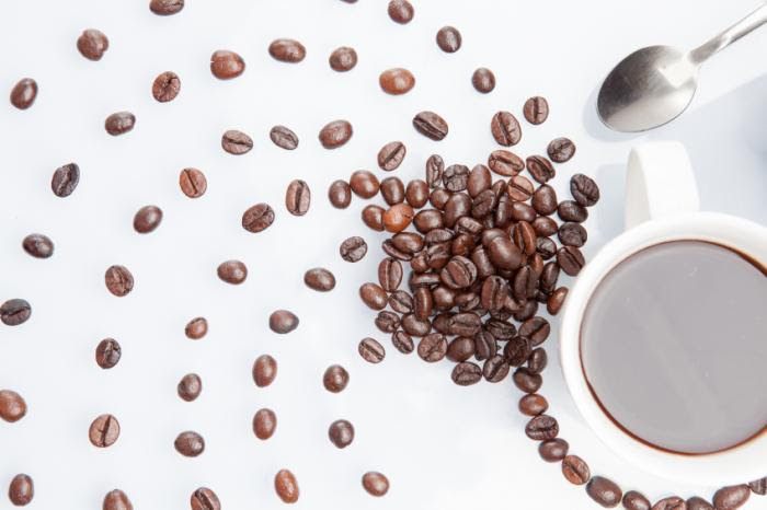 coffee beans with cup of coffee