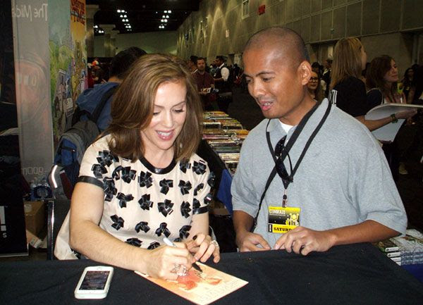 Getting an autograph by Alyssa Milano at Stan Lee's Comikaze Expo in downtown Los Angeles, on November 2, 2013.