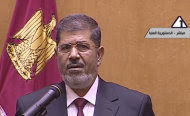 In this image made from Egyptian State Television, Egyptian President Mohammed Morsi makes remarks after he was sworn in at the Supreme Consitutional Court in Cairo, Egypt, Saturday, June 30, 2012. Islamist Mohammed Morsi has been sworn in before Egypt's highest court as the country's first freely elected president, succeeding Hosni Mubarak who was ousted 16 months ago. (AP Photo/Egyptian State TV)