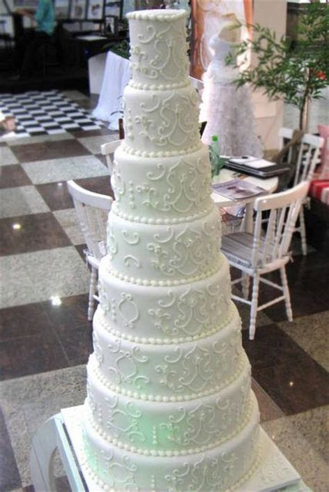 8 tier round white wedding cake with pearl beads