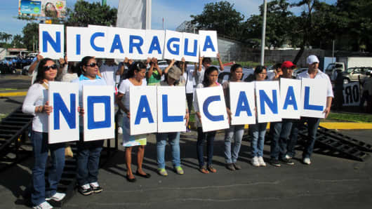 Thousands of demonstrators march against the 173-mile Interoceanic Grand Canal that they say will negatively impact the environment, communities and Nicaraguan sovereignty, in Managua, Nicaragua, December 10, 2014.