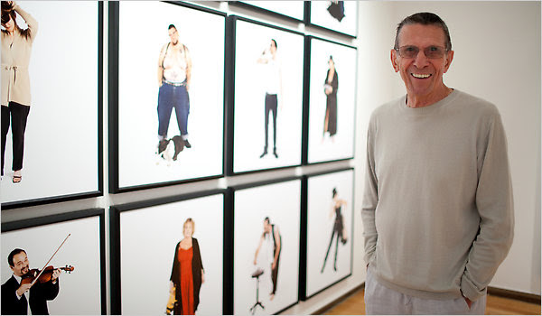 Leonard Nimoy in front of some of his portraits