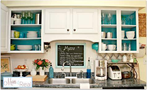 open cabinets  white aqua lime green silver