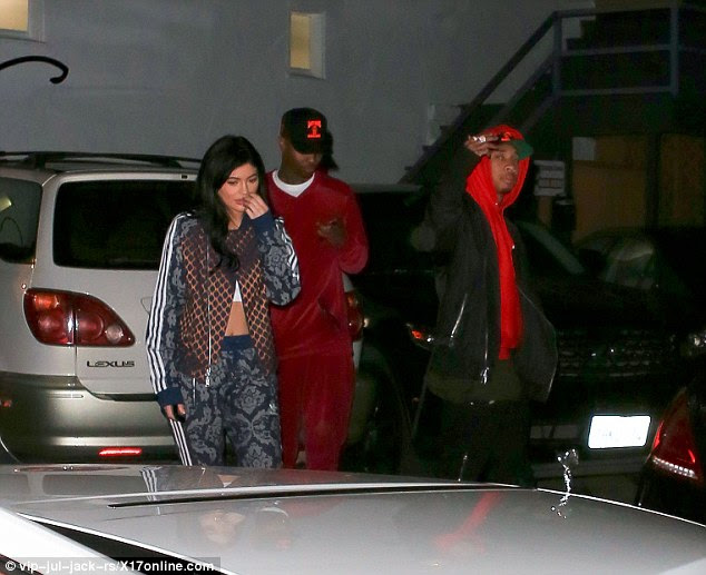 Back on? The 18-year-old reality starlet and Tyga (pictured right) were putting on a united front as they stepped out in Hollywood on Friday night with a group of pals after she was spied picking up some groceries earlier in the day