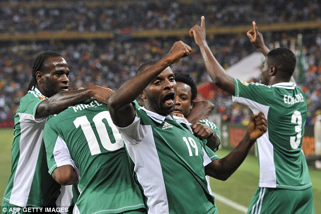 Winner: Sunday Mba is congratulated by Nigeria team-mates after firing the only goal of the game