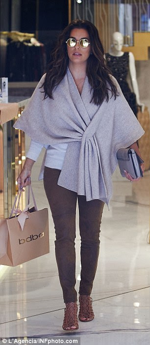 Going solo: Leaving her husband-to-be in the hotel, the sexy star was seen wrapping up in a co-ordinated outfit as she purchased a few luxury clothes items