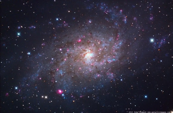 M33, the Triangulum Spiral Galaxy, seen here in a 4.3  hour exposure image. Credit and copyright: John Chumack.