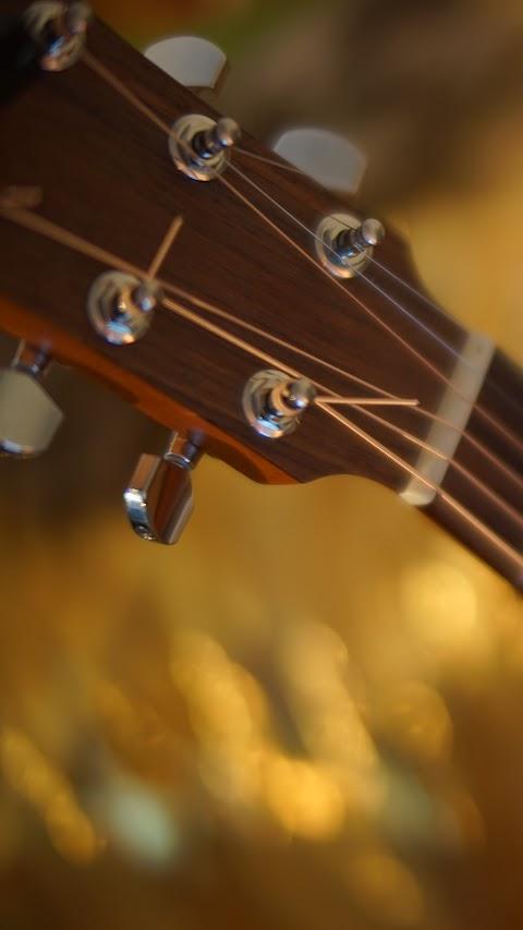 خلفية موسيقية جميلة لعشاق الة العود او الكيتار ايفون كلاكسي بدقة عالية