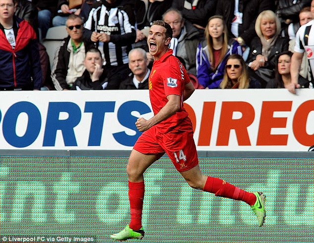 More to come: Jordan Henderson wheels away in celebration after scoring his first goal