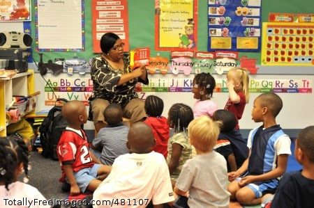 Staff takes Joyce Matthews, lead pre-kindergarten teacher at the Fort McPherson Child Development Center, demonstrates to students how to call 