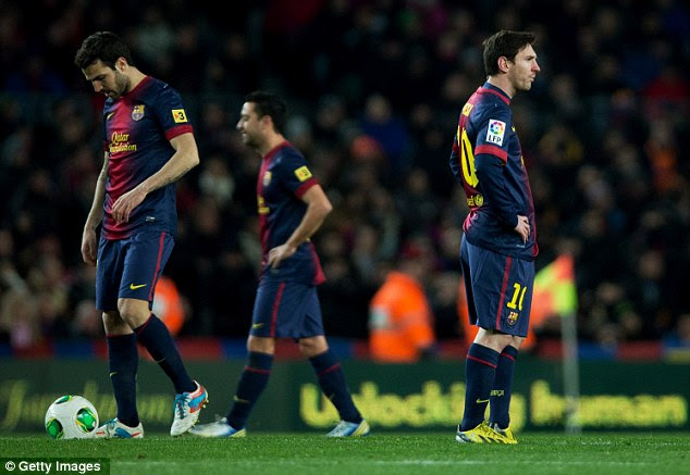 Downbeat: Lionel Messi looked dejected as Madrid cruised past Barcelona
