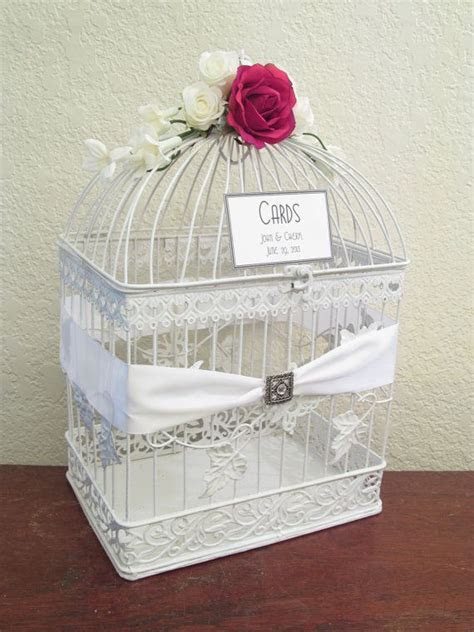 use a vintage bird cage as our wedding card box and