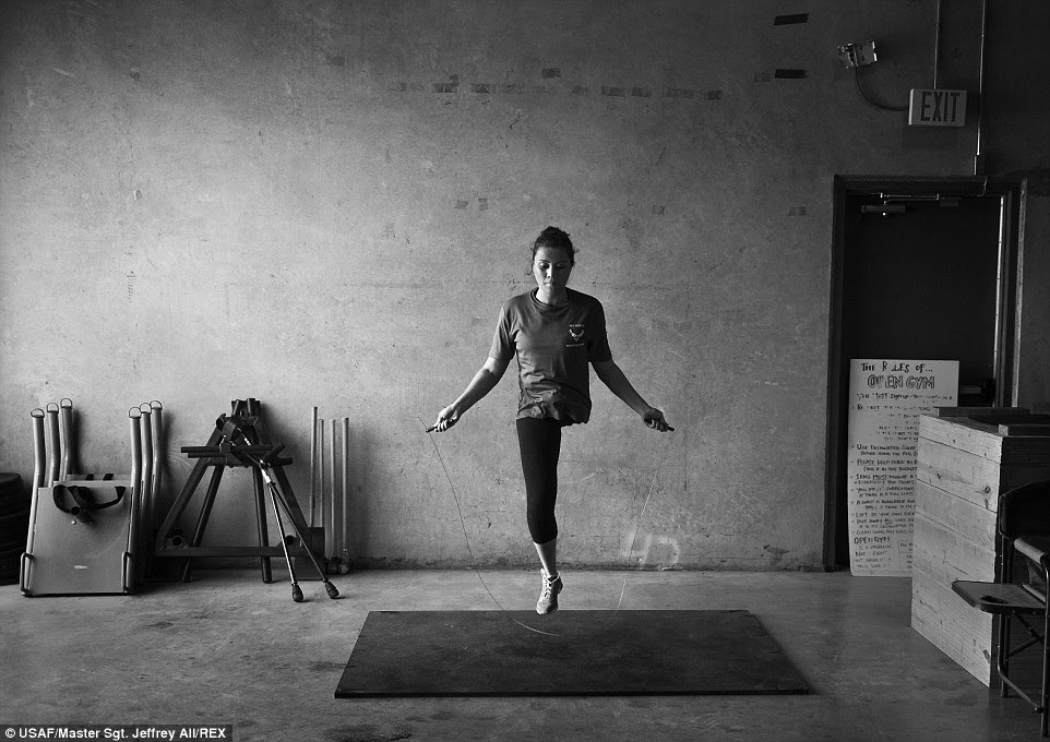 Ability: Retired U.S. Air Force Captain Sarah Evans jumps rope at a Cross Fit gym in San Antonio, Texas. Evans, lost her left leg to an aggressive form of bone cancer, but works out regularly and competes the military's Warrior games