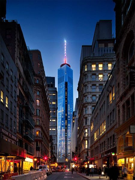The 1 WTC's antenna spire shines above New York City's streets, on April 28, 2014.