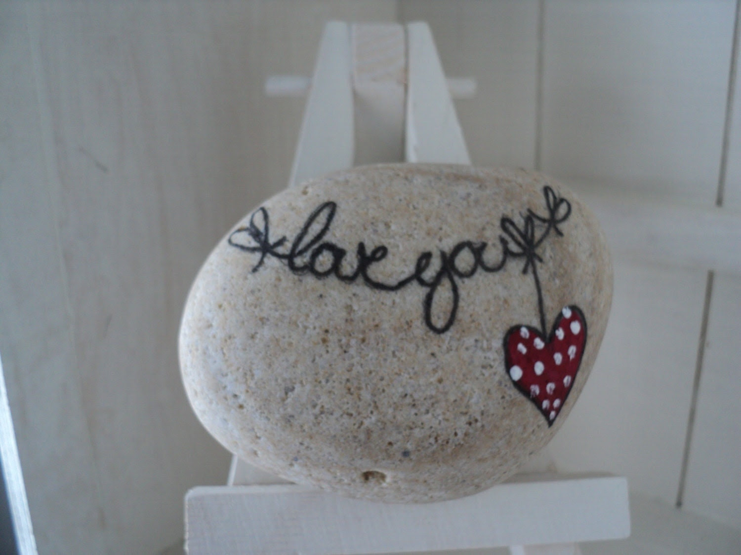 Unique hand painted Valentines love messages on Lake Erie beach stones.