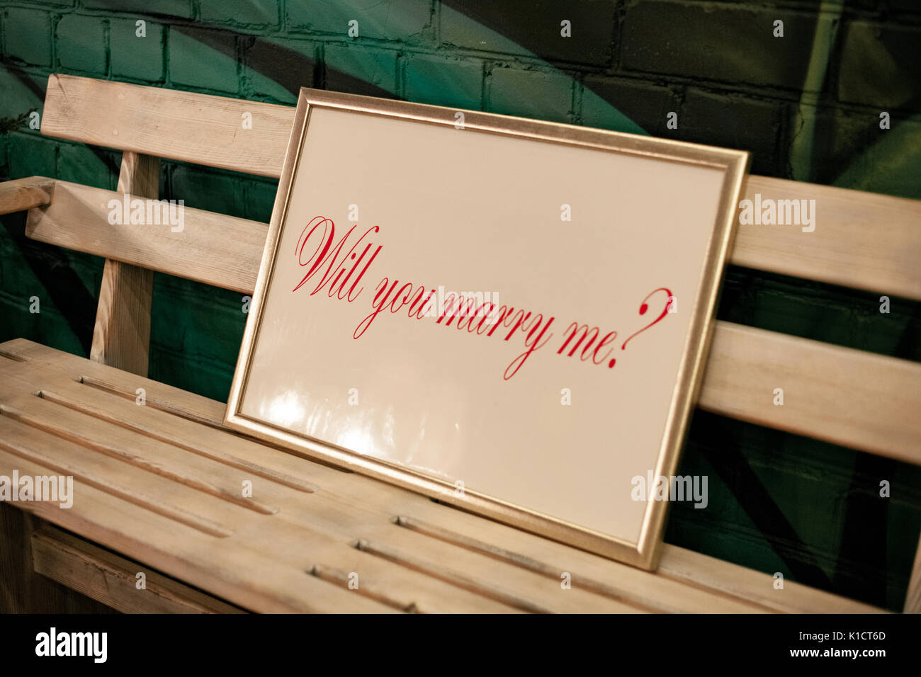 Label With Frame And Inscription Will You Marry Me On Wooden Bench