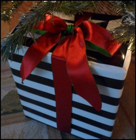 black and white striped paper with red satin ribbon with reversible green side.