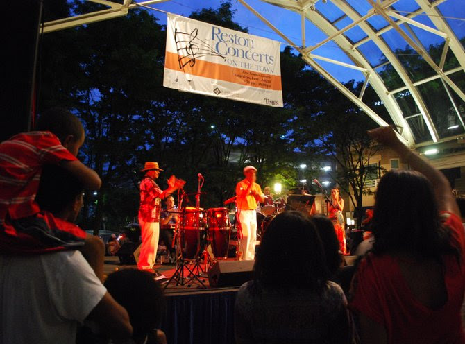 Adults and children alike groove along to the salsa and Afro-Cuban music at a Reston Town Center Concert.