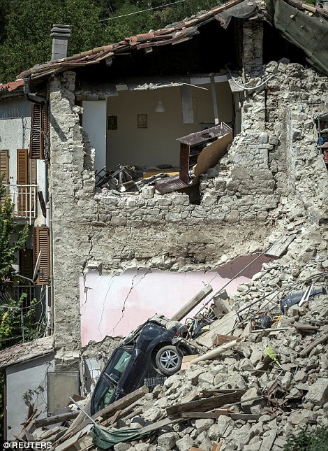 Some of the worst damage was suffered in Pescara del Tronto, a hamlet near Arquata in the Marche region where the bodies of the dead were laid out in a children's play park