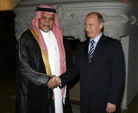 Prince Bandar bin Sultan (L), Secretary-General of Saudi Arabia's National Security Council, shakes hands with Russia's Prime Minister Vladimir Putin in Moscow July 14, 2008. RUSSIA/RIA Novosti/Alexei Druzhinin/Pool