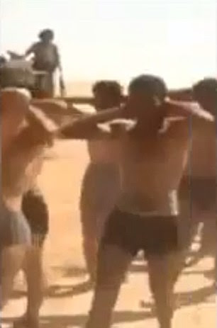 Marched: Earlier stills from the video showed men being paraded in their underwear and ordered to chant