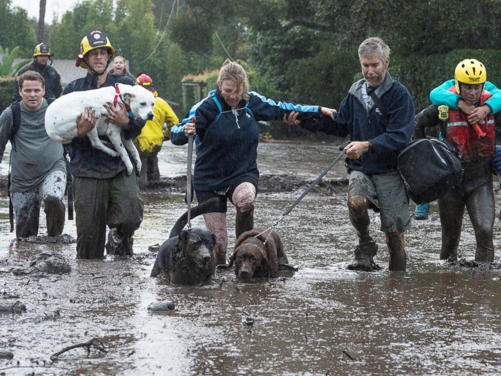 PHOTO: Emergency personnel evacuate local residents and their dogs after a mudslide in Montecito, Calif., Jan. 9, 2018.