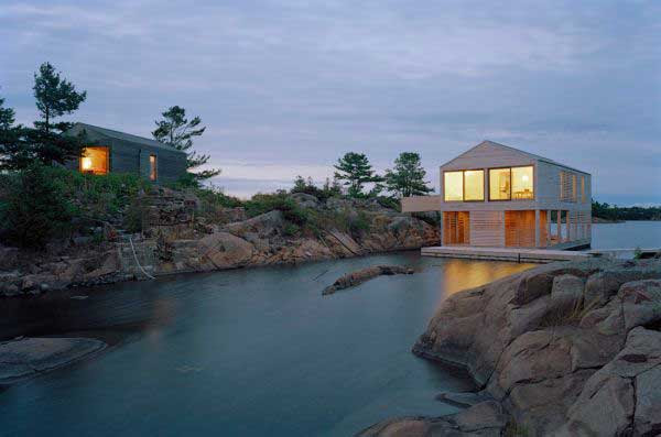 Floating-House-with-an-Integrated-Boathouse-and-Dock-3