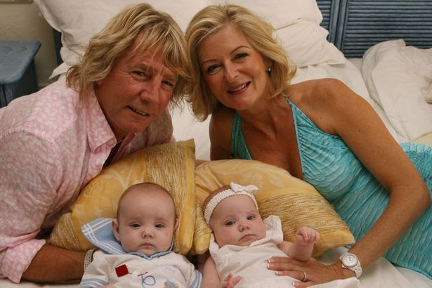 Rick Parfitt proudly shows off his baby twins Tommy Oswald and Lily Rose