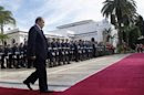 Algeria's President Bouteflika walks towards Spain's PM Rajoy during a welcoming ceremony at the presidential palace in Algiers