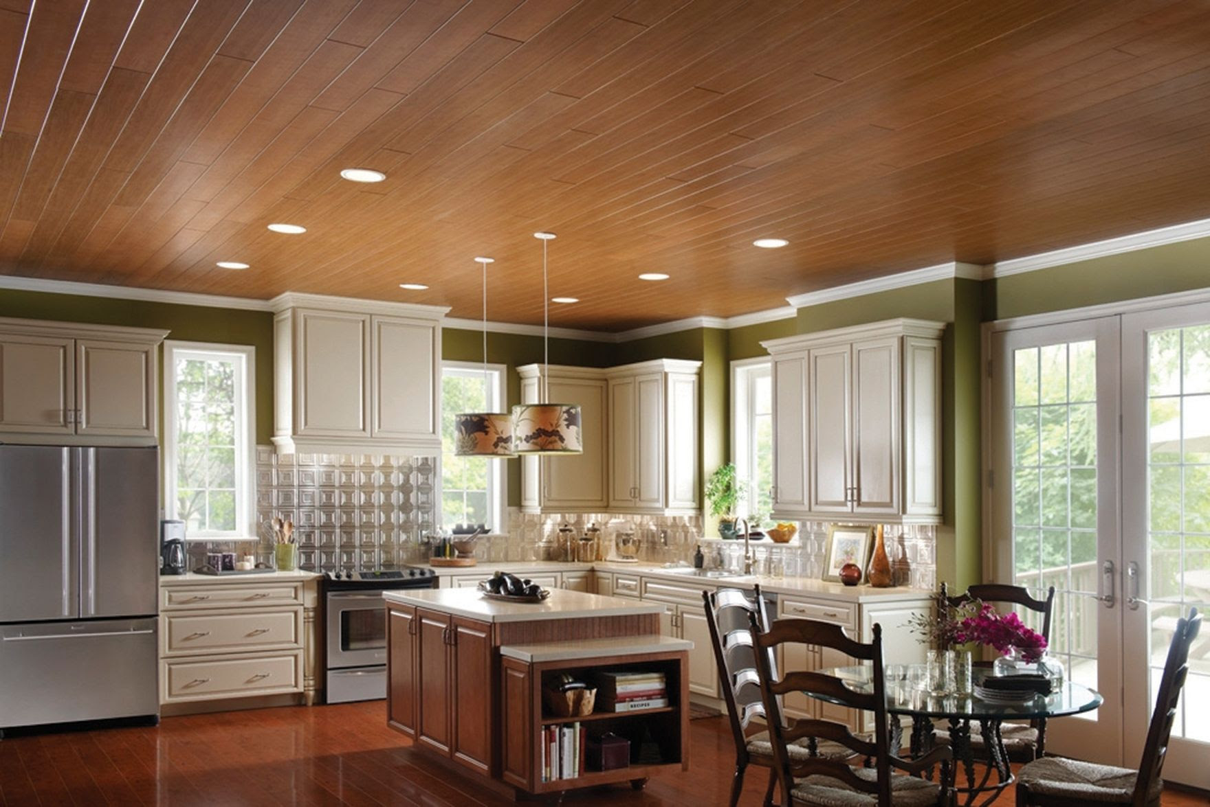 kitchen with dark wooden ceiling planks and white cabinets.