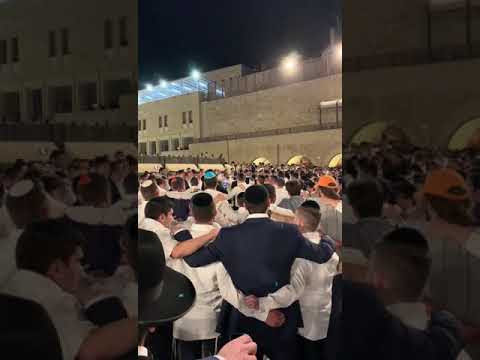 Hundreds of Jews singing Acheny at the Western Wall after the Merton Tragedy