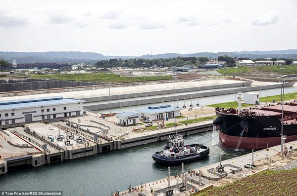The Baroque Valetta passes through the Panama Canal's new set of locks during a trial run on June 9, 2016.