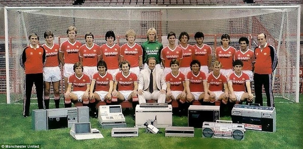 Electronic goods: Ron Atkinson and the 1982-83 team pose with a range of goods to mark a sponsorship deal with Sharp