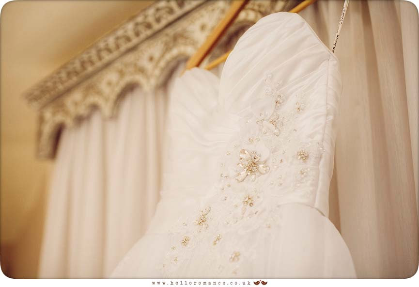 Wedding Dress hung up at Haughley Park Barn Suffolk Wedding Photography - www.helloromance.co.uk