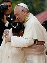 Pope Francis embraces a teen during his January 2015 visit to the Philippines. CNS Photo/Paul Haring