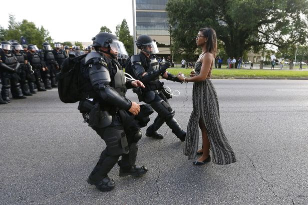 Image result for black women in dress against cops