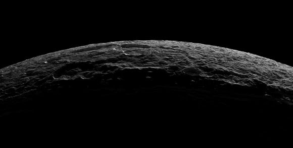 Crescent Dione from Cassini, October 11, 2005. The crater near the limb at top is Alcander, with larger crater Prytanis adjacent to its left. At lower right, several of the Palatine Chasmata fractures are visible, one of which can be seen bisecting the smaller craters Euryalus (right) and Nisus. NASA / Jet Propulsion Laboratory / Space Science Institute