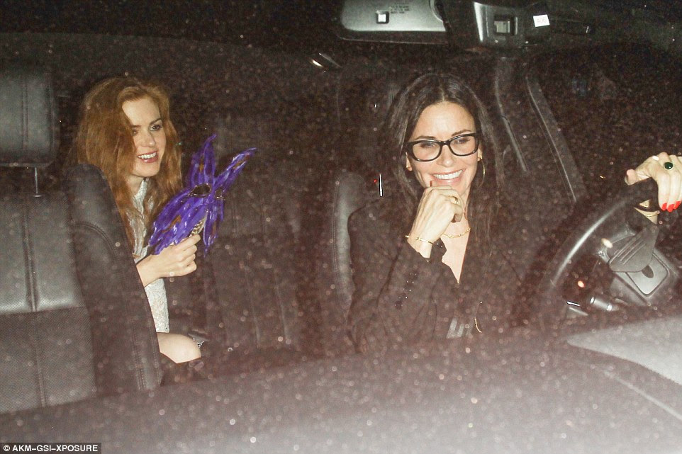 Need a ride home? A bleary-eyed Isla took a backseat role and was given a ride home by Reese and Jen's pal Courteney Cox