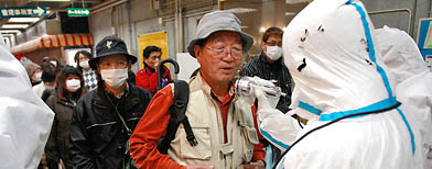 People are re-checked for radiation exposure after being decontaminated in Nihonmatsu, Fukushiima.. (AP Photo/Wally Santana)