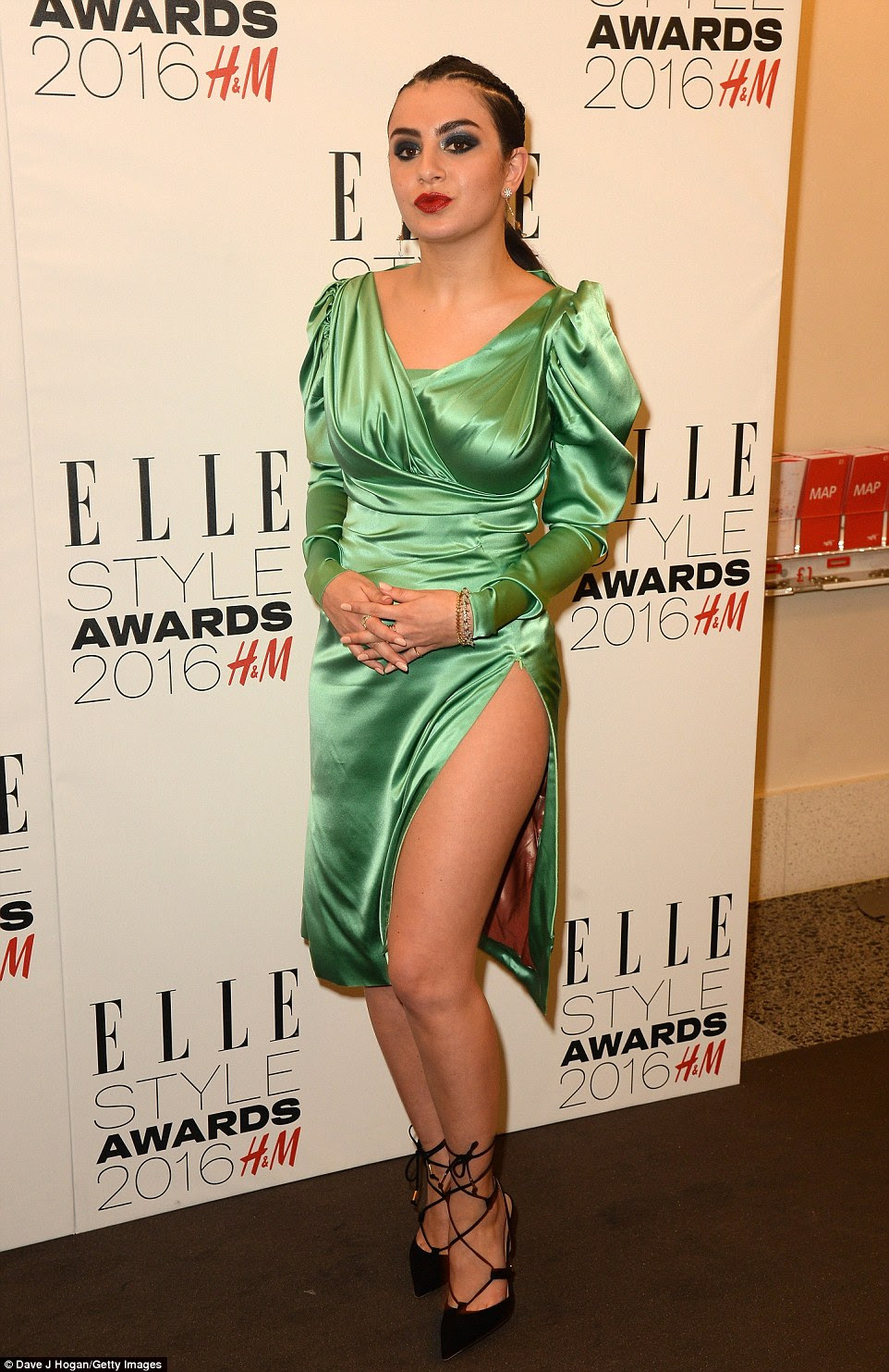 Unorthodox: Charli XCX, meanwhile, seemed to have got dressed in the dark when it came to her retro green dress