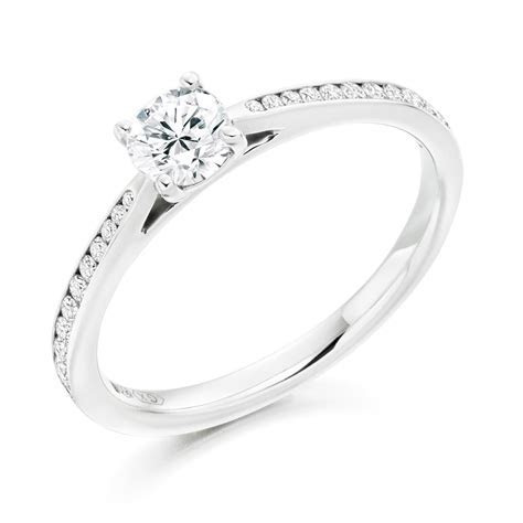 Platinum Solitaire & Channel Set Shoulders Diamond