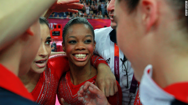 Gabrielle Douglas of the United States celebrates with teammates during the gymnastics women's team final.