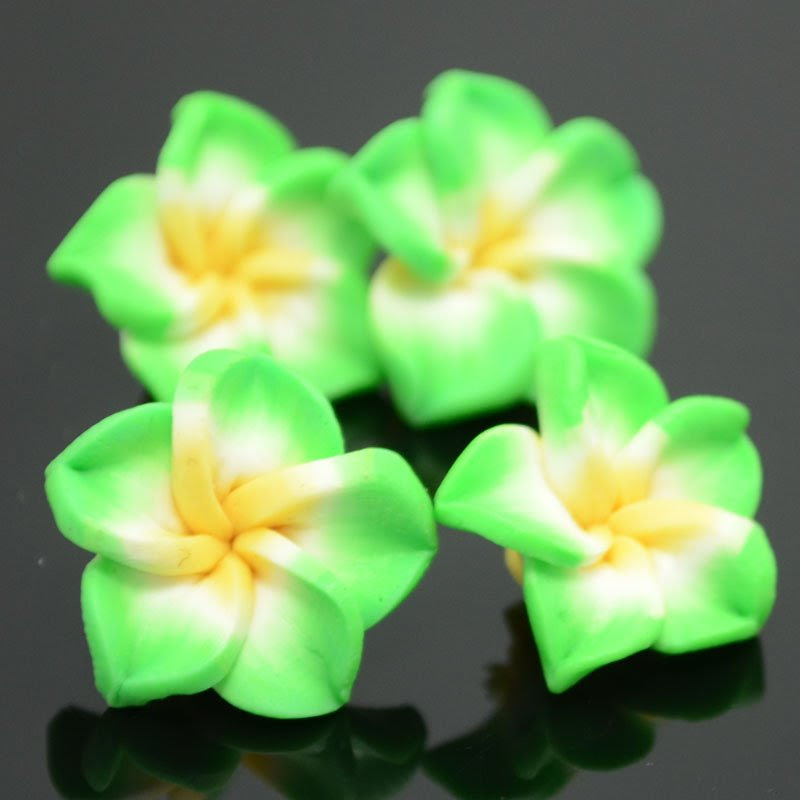 s37396 Polymer Clay - 15 mm Plumeria Flower - Compassion Conquers Envy (1)