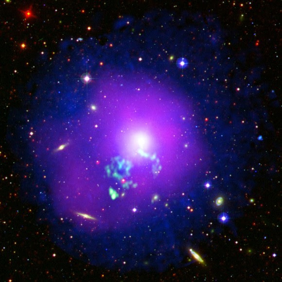 NGC 5044 as seen in a composite image from the Wide-field Infrared Survey Explorer, the Digitized Sky Survey (optical), Galex (near-ultraviolet) and new X-ray observations from XMM-Newton (in blue.) Astronomers say they are able to see hot gas moving in this galaxy because of an interaction with another galaxy millions of years ago. Credit: E. O'Sullivan & ESA