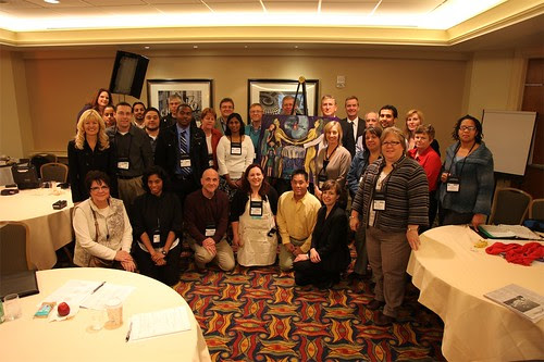 """The EMR crowd at IHI beside Regina Holliday's New Painting """"Patient Centered Care"""""""