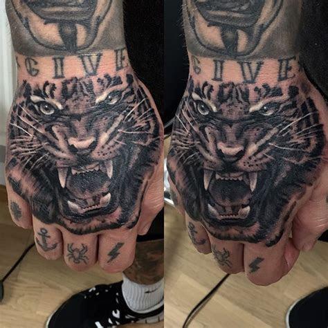 tiger face hand tattoo tattoo geek ideas tattoos