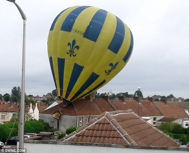 Running out of air: The hot-air balloon lost height after the father-and-son crew swapped over the gas cylinders and hit a chimney pot